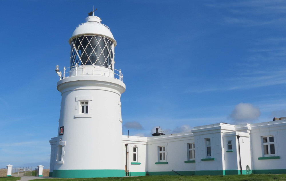 Light house holidays - this one if Pendeen Lighthouse in Cornwall