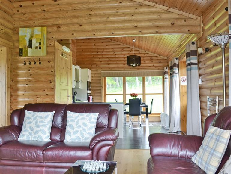 Living room in Ashknowe Log Cabin, Perthshire