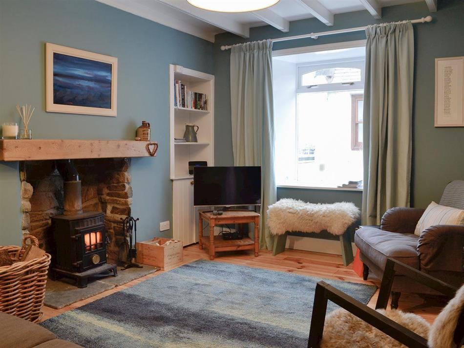 Living room with a wood burner in Low Shore, Whitehills, near Banff