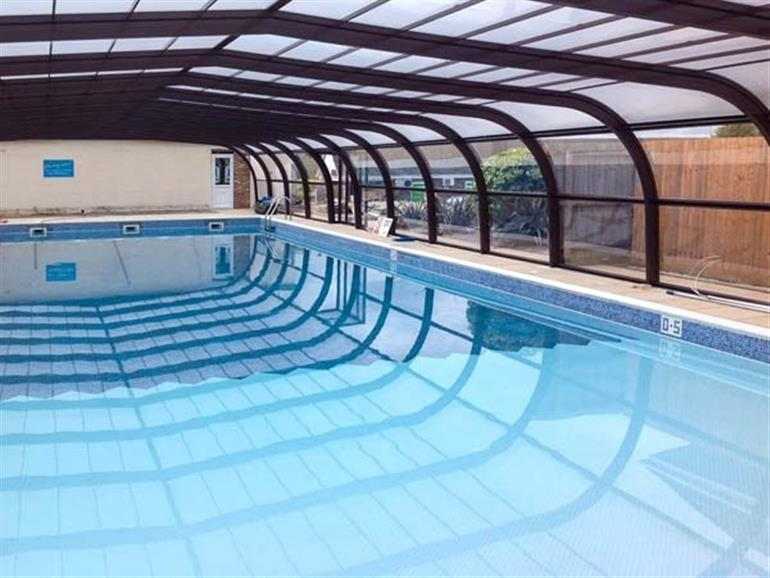 The indoor swimming pool at Coastal Villa