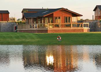 Relax in your Hot Tub with a glass of wine at Heron Lakes Lodges
