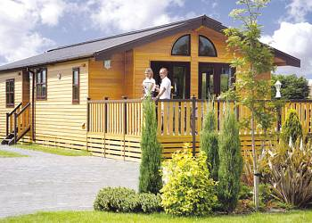 Relax in a Hot Tub at Hollybrook Lodges