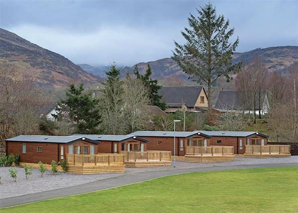 Relax in your Hot Tub with a glass of wine at Loch Ness Retreat