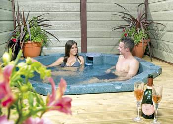 Relax in your Hot Tub with a glass of wine at Swainswood Park