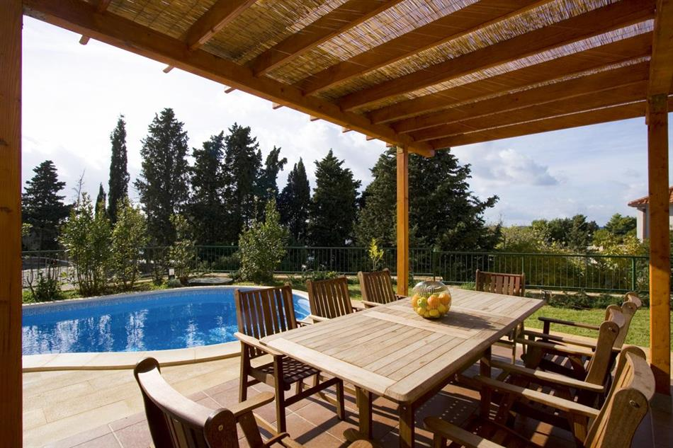 Garden, pool, and shaded dining area at Villa Vanja, Croatia